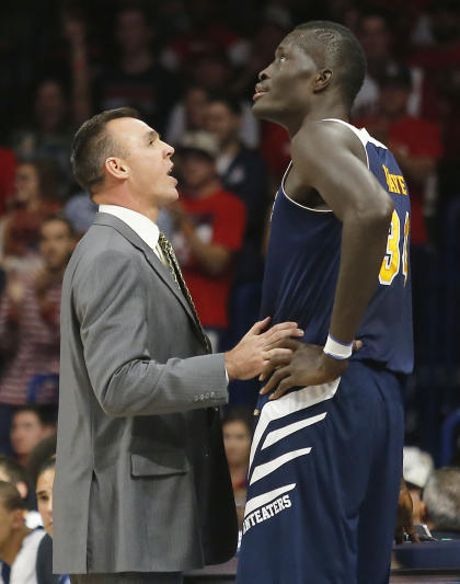 UC Irvine coach Russell Turner, left, talks to center Mamadou Ndiaye (AP Photo/Rick Scuteri)
