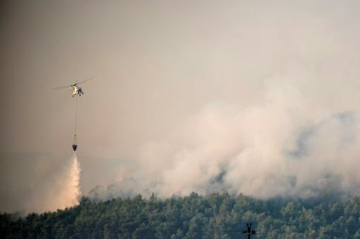 Over 200 firefighters were on the front line on Greece's second largest island, backed by 75 fire trucks, nine water-bombing helicopters and seven planes