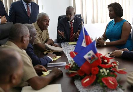 Haitian President Jovenel Moise and Chief of the army's high command Jodel Lessage during a meeting at the Defence Ministry during the establishment of the Joint Chiefs of Staff of the Haitian Armed Forces (FAD'H) in Port-au-Prince, Haiti, March 27, 2018. REUTERS/Andres Martinez Casares