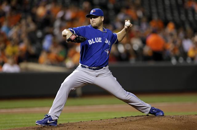 Toronto Blue Jays starting pitcher Mark Buehrle throws to the Baltimore Orioles in the first inning of a baseball game, Thursday, Sept. 26, 2013, in Baltimore. (AP Photo/Patrick Semansky)