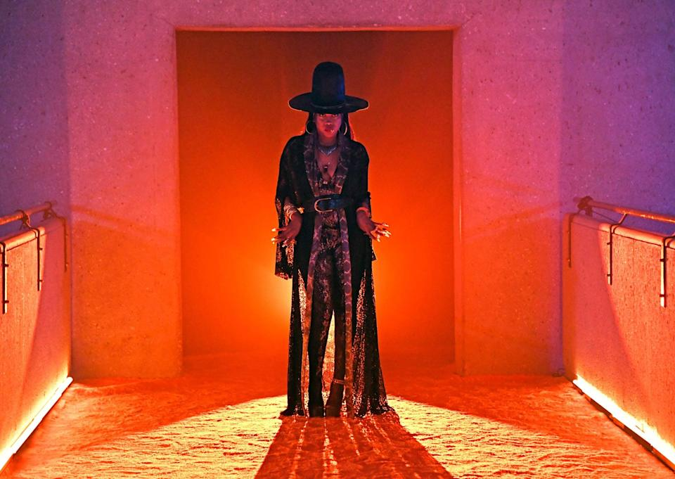 <p>Erykah Badu wears a snake print bodysuit and matching robe for her Savage X Fenty Vol. 3 Show appearance.</p>