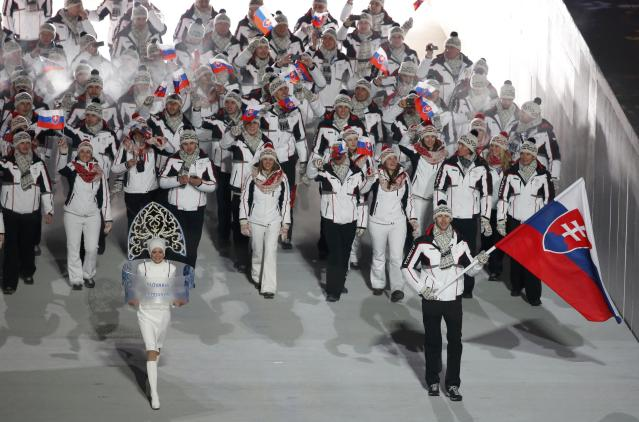 Slovakia's flag-bearer Zdeno Chara leads his country's contingent during the opening ceremony of the 2014 Sochi Winter Olympics, February 7, 2014. REUTERS/Lucy Nicholson (RUSSIA - Tags: OLYMPICS SPORT)