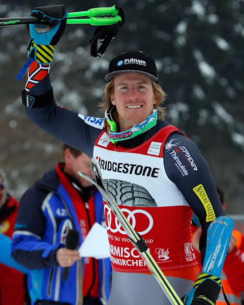 Ted Ligety, of the United States, celebrates after finishing third in an alpine ski, men's world cup giant slalom in Garmisch-Partenkirchen, Germany, Sunday, Feb. 24, 2013. (AP Photo/Alessandro Trovati)