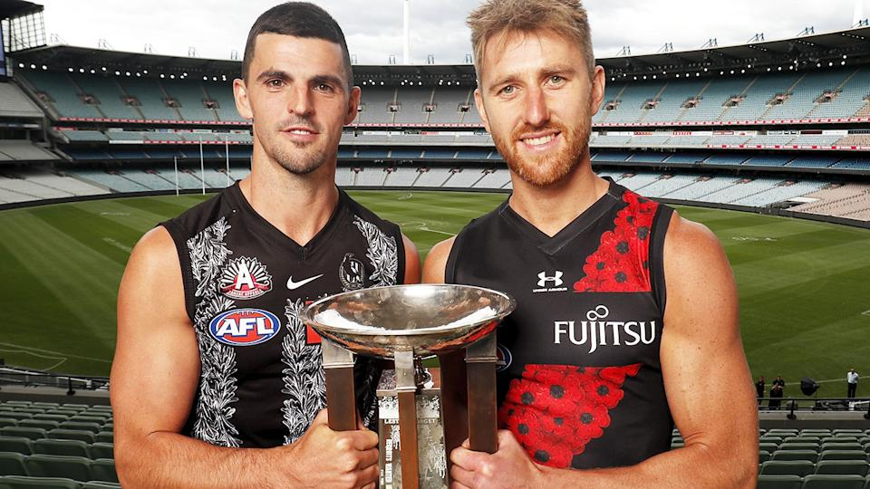 Scott Pendlebury and Dyson Heppell, pictured here in their Anzac Day strips.