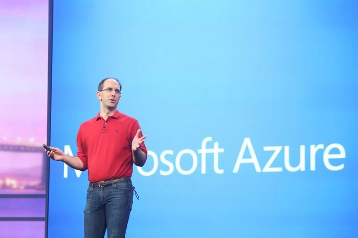 Microsoft executive Scott Guthrie onstage, in front of a screen with the words Microsoft Azure