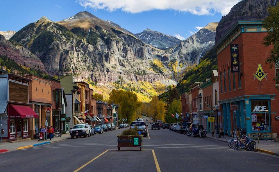 """<p>Eight by 12 city blocks make up the entirety of <a href=""""https://www.telluride.com/"""" rel=""""nofollow noopener"""" target=""""_blank"""" data-ylk=""""slk:Telluride, Colorado"""" class=""""link rapid-noclick-resp"""">Telluride, Colorado</a> nestled between 13,000-foot peaks. Don't be deceived by its small footprint as it's packed with boutiques and art galleries alongside unique """"Victorian-era"""" homes. Beyond the galleries is the Telluride Arts District with a mission to """"sustain, promote, and expand a culture of the arts."""" It's a place where art is thriving and citizens are making sure that special architectural buildings are rightfully preserved in American history. </p>"""
