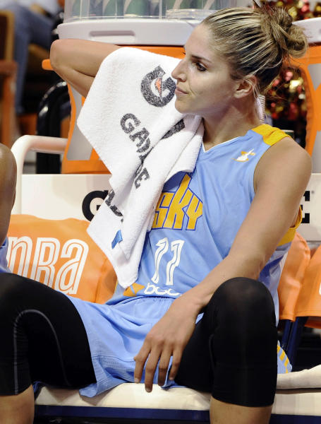 FILE - In this July 12, 2013, file photo, Chicago Sky's Elena Delle Donne sits on the the bench during the first half of a WNBA basketball game against the Connecticut Sun in Uncasville, Conn. Delle Donne will miss the WNBA All-Star game on Saturday while recovering from a concussion. The No. 2 pick in the draft was injured in the Sky's loss to Washington on Wednesday when she was going for a loose ball with a minute left in the third quarter. (AP Photo/Jessica Hill, File)