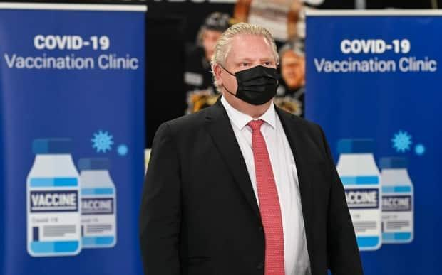Ontario Premier Doug Ford attends a press conference after touring a mass COVID-19 vaccination site in Hamilton last month. (Nathan Denette/The Canadian Press - image credit)