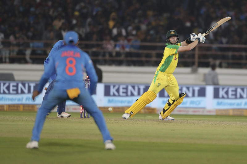 Australia's Steve Smith is bowled out by India's Kuldeep Yadav during the second one-day international cricket match between India and Australia in Rajkot, India, Friday, Jan. 17, 2020. (AP Photo/Ajit Solanki)