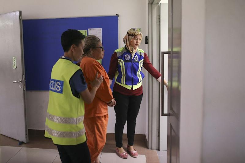Siti Kasim is seen in the Kajang Court Complex on June 24, 2018, after being arrested for allegedly kidnapping a woman whom the lawyer insisted she had rescued from the latter's mother. — Picture by Azneal Ishak