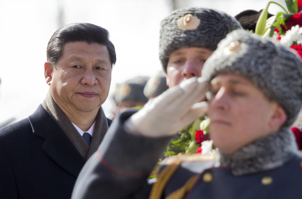 Chinese President Xi Jinping attends a wreath laying ceremony at the Tomb of Unknown Soldier in Moscow, Russia, Friday, March 22, 2013. Russia is Xi Jinping's first foreign destination as China's president. Xi's talks with Putin on Friday are set to focus on oil and gas as China seeks to secure new energy resources to fuel its growing economy. (AP Photo/Misha Japaridze)