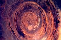 Dutch astronaut Andre Kuipers snapped a huge, copper-toned rock formation in Mauritania, West Africa, from the International Space Station. Photo credit: Nasa