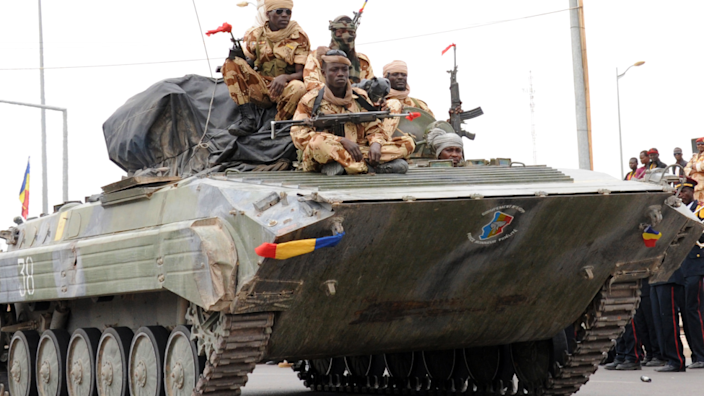 Chadian soldiers returning from Mali sit on a chariot during a procession through the capital N'Djamena - 2013