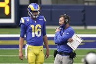 Los Angeles Rams head coach Sean McVay, right, talks to quarterback Jared Goff (16) during the second half of an NFL football game Sunday, Oct. 4, 2020, in Inglewood, Calif. The most recognizable trend in hiring NFL head coaches has been to target young, innovative offensive teachers with a track record of developing quarterbacks. (AP Photo/Jae C. Hong)