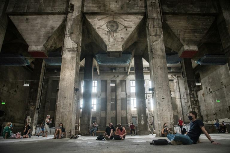 Visitors to the former power plant listen to the eery sound installation after Berlin's Berghain club re-opened its doors