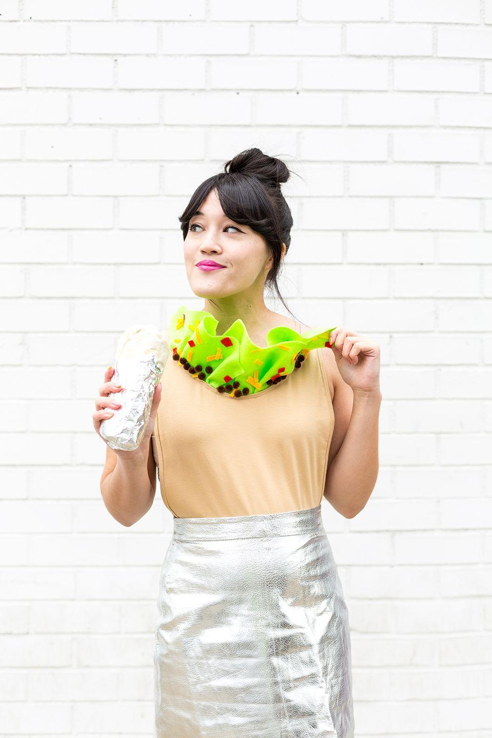 """<p>This creative costume only takes ten minutes to make. Say what??? All you need is a silver skirt, silver shoes, a tan (read: burrito-colored) top and a little bit of handiwork for your collar, and you'll be good to go.</p><p><em><a href=""""http://www.awwsam.com/2017/10/diy-burrito-halloween-costume.html"""" rel=""""nofollow noopener"""" target=""""_blank"""" data-ylk=""""slk:Get the tutorial at Aww Sam »"""" class=""""link rapid-noclick-resp"""">Get the tutorial at Aww Sam »</a></em> </p><p><strong>RELATED</strong>: <a href=""""https://www.goodhousekeeping.com/holidays/halloween-ideas/a33967140/what-should-i-be-for-halloween/"""" rel=""""nofollow noopener"""" target=""""_blank"""" data-ylk=""""slk:Not Sure What to Be for Halloween This Year? Take This Quiz to Find Out"""" class=""""link rapid-noclick-resp"""">Not Sure What to Be for Halloween This Year? Take This Quiz to Find Out</a></p>"""