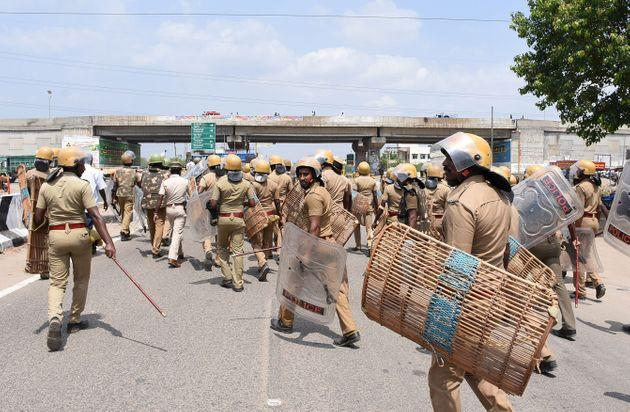 Indian police officials move towards protestors in Thoothukudi on May 22, 2018. Around 13 people were killed when police fired at a crowd protesting against the proposed expansion of a copper smelter plant run by Sterlite Corporation.