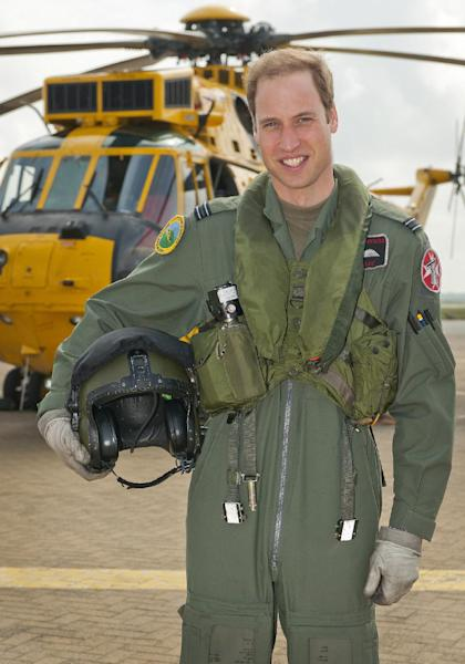 FILE - In this Friday June 1, 2012 file image released by Britain's Ministry of Defence Britain's Prince William poses in front of a Sea King helicopter at RAF Valley in Anglesey Wales. Britain's search-and-rescue helicopter service, which employs Prince William is to be run by US-headquartered Bristow Helicopters, the Government announced Tuesday March 26, 2013 .The decision ends 70 years of the service run by the RAF and Royal Navy squadrons. (AP Photo/ SAC Faye Storer, MOD, File)