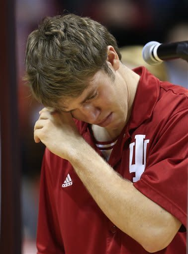 Indiana guard Jordan Hulls wipes his face during his senior night speech following an NCAA college basketball game against Ohio State Wednesday, March 6, 2013, in Bloomington, Ind. Ohio State defeated Indiana 67-58. (AP Photo/Darron Cummings)