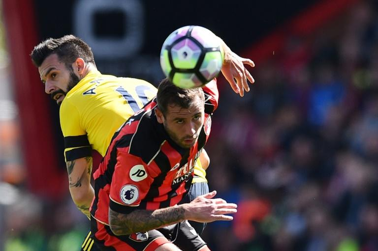 Middlesbrough's Alvaro Negredo (L) vies with Bournemouth's George Friend during their English Premier League football match at the Vitaly Stadium in Bournemouth, southern England on April 22, 2017