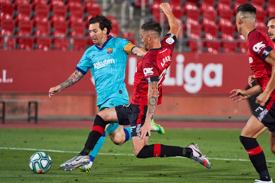 Barcelona's Lionel Messi goes for the ball against Mallorca during a La Liga match on Saturday in Mallorca, Spain. (Photo by Rafa Babot/MB Media/Getty Images)