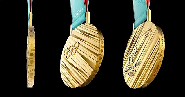"<p>The medals for the 2018 Winter Olympics were inspired by Hangeul, the Korean alphabet. Viewed from the side, Korean consonants spell '<a href=""https://www.pyeongchang2018.com/en/medal"" rel=""nofollow noopener"" target=""_blank"" data-ylk=""slk:Olympic Winter Games PyeongChang 2018"" class=""link rapid-noclick-resp"">Olympic Winter Games PyeongChang 2018</a>.' The gold medal weighs 586 grams (1.29 pounds)–believed to be the <a href=""http://olympics.nbcsports.com/2017/09/20/pyeongchang-olympic-medals-unveiled/"" rel=""nofollow noopener"" target=""_blank"" data-ylk=""slk:heaviest"" class=""link rapid-noclick-resp"">heaviest</a> in Olympic history.<br> (Photo via Facebook/swna) </p>"