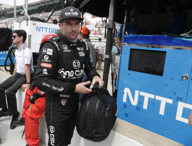 Jay Howard, of England, walks away from his car after qualifying for the IndyCar Indianapolis 500 auto race at Indianapolis Motor Speedway in Indianapolis, Sunday, May 20, 2018. (AP Photo/Michael Conroy)