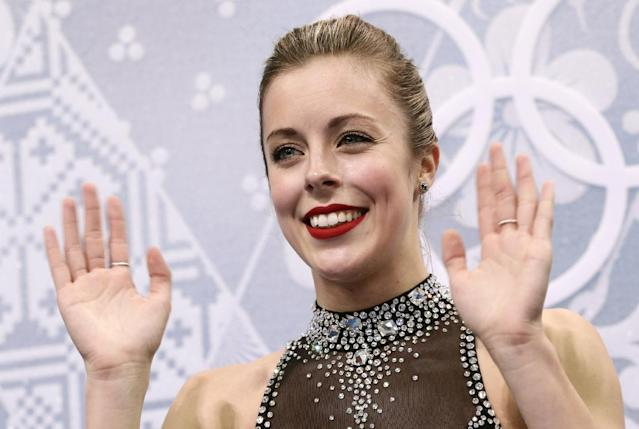Ashley Wagner of the United States waves to spectators as she waits in the results area after completing her routine in the women's short program figure skating competition at the Iceberg Skating Palace during the 2014 Winter Olympics, Wednesday, Feb. 19, 2014, in Sochi, Russia. (AP Photo/Bernat Armangue)