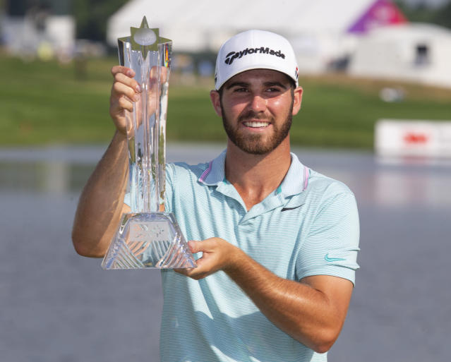 Matthew Wolff holds the trophy after winning the 3M Open golf tournament Sunday, July 7, 2019, in Blaine, Minn. (AP Photo/Andy Clayton- King)