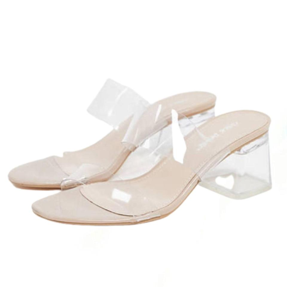 """Chic yet understated, these lucite mules are a secret wedding weapon. Plus, you don't have to worry if someone spills a drink on them... $48, ASOS. <a href=""""https://www.asos.com/us/public-desire-wide-fit/public-desire-aries-wide-fit-mule-with-clear-details-in-beige/prd/20077563?"""" rel=""""nofollow noopener"""" target=""""_blank"""" data-ylk=""""slk:Get it now!"""" class=""""link rapid-noclick-resp"""">Get it now!</a>"""