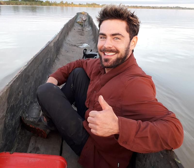 Actor Zac Efron pictured giving a thumbs up in a canoe in Papua New Guinea.