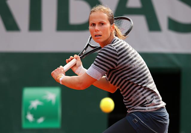 PARIS, FRANCE - MAY 31: Varvara Lepchenko of the United States of America plays a backhand during her Women's Singles match against Angelique Kerber of Germany on day six of the French Open at Roland Garros on May 31, 2013 in Paris, France. (Photo by Julian Finney/Getty Images)