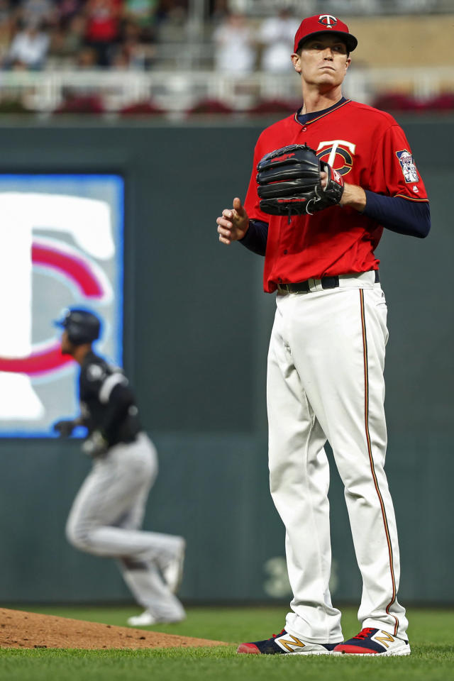Minnesota Twins starting pitcher Kyle Gibson waits for a new ball as Chicago White Sox's Jose Abreu runs the bases on his three-run home run in the third inning of a baseball game Monday, Aug 19, 2019, in Minneapolis. (AP Photo/Bruce Kluckhohn)