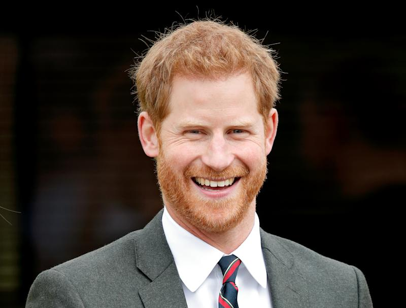 Prince Harry smiling in grey morning suit