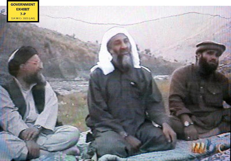 In this undated Photo provided by the United States Attorney's Office for the Southern District of New York,  defendant Suliman Abu Ghayth, right, is seated with  al-Qaida founder Osama Bin Laden, center, and Bin Laden's deputy, Ayman al Zawahiri, in Afghanistan. Suliman Abu Ghayth, is being tried in New York, charged with plotting to kill Americans by being a motivational speaker at al-Qaida training camps before the Sept. 11 attacks and as a spokesman for the terror group afterward when it sought to recruit more militants to its cause. (AP Photo/US Attorney's Office for the Southern District of New York)