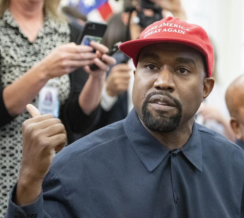 Close-up of American rapper and producer Kanye West in the White House's Oval Office, Washington DC, October 11, 2018. He wears a red baseball cap that reads 'Make America Great Again.' (Photo by Ron Sachs/Consolidated News Pictures/Getty Images)