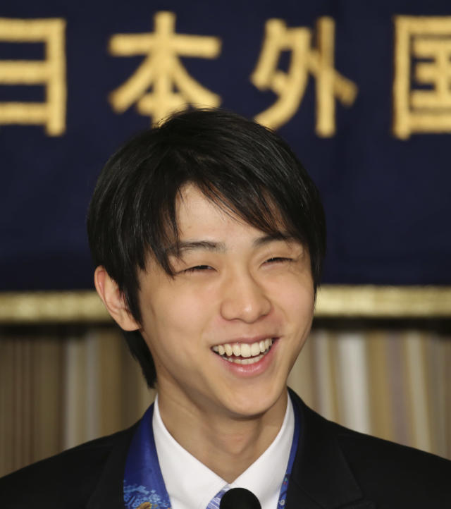 Sochi Winter Olympics men's figure skating gold medalist Yuzuru Hanyu smiles during a press conference at the Foreign Correspondents' Club of Japan in Tokyo Thursday, April 24, 2014. After winning just about everything there was to win in 2014, Japanese skater Hanyu says there is still room for improvement as he prepares for another season. (AP Photo/Koji Sasahara)