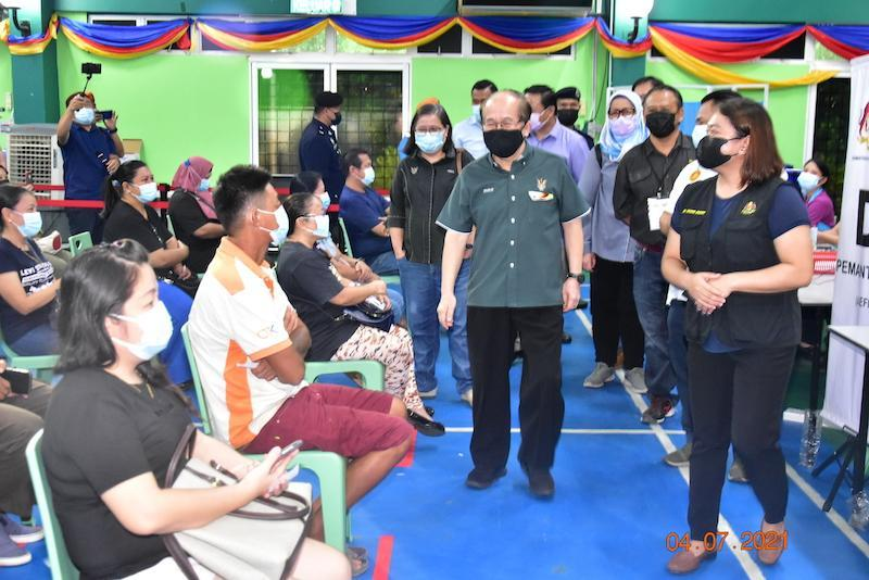 Deputy Chief Minister Datuk Amar Douglas Uggah (centre) visits the vaccine administration centre at the Fire and Rescue Department Academy in Bau July 4, 2021. — Picture courtesy of the Chief Minister's Office