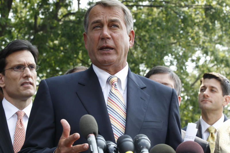 House Speaker John Boehner of Ohio, center, stands with, from left, House Majority Leader Eric Cantor of Va., left, and House Budget Committee Chairman Paul Ryan, R-Wis., as he speaks to reporters outside the White House in Washington, Wednesday, June 1, 2011, after their meeting with President Barack Obama regarding the debt ceiling. (AP Photo/Charles Dharapak)