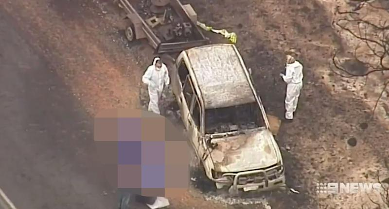 The Lang's burnt out vehicle at the side of the Playford Highway. Source: Nine News
