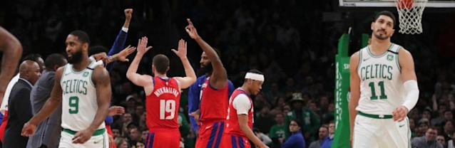 The Detroit Pistons celebrate in their victory over the Boston Celtics.