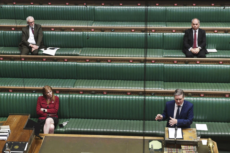 In this handout photo provided by the UK Parliament, Britain's Labour leader Keir Starmer speaks during Prime Minister's Questions, as members of Parliament observe social distancing due to the coronavirus, in the House of Commons, London, Wednesday, April 29, 2020. (Jessica Taylor/PA via AP)