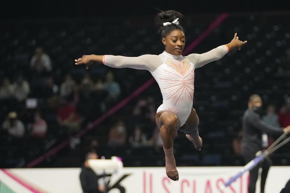 Simone Biles performs her floor routine during the U.S. Classic gymnastics event in Indianapolis, Saturday, May 22, 2021. (AP Photo/AJ Mast)