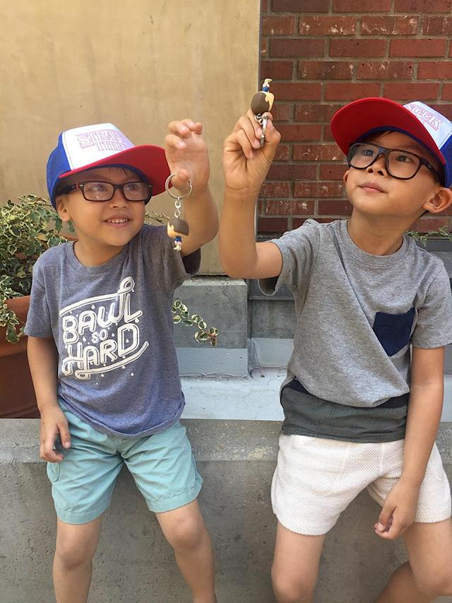 <p>Two of <i>Stranger Things</i>' littlest fans play with their Eleven souvenirs while rocking Dustin hats. <br><br>(Photo: Yahoo) </p>