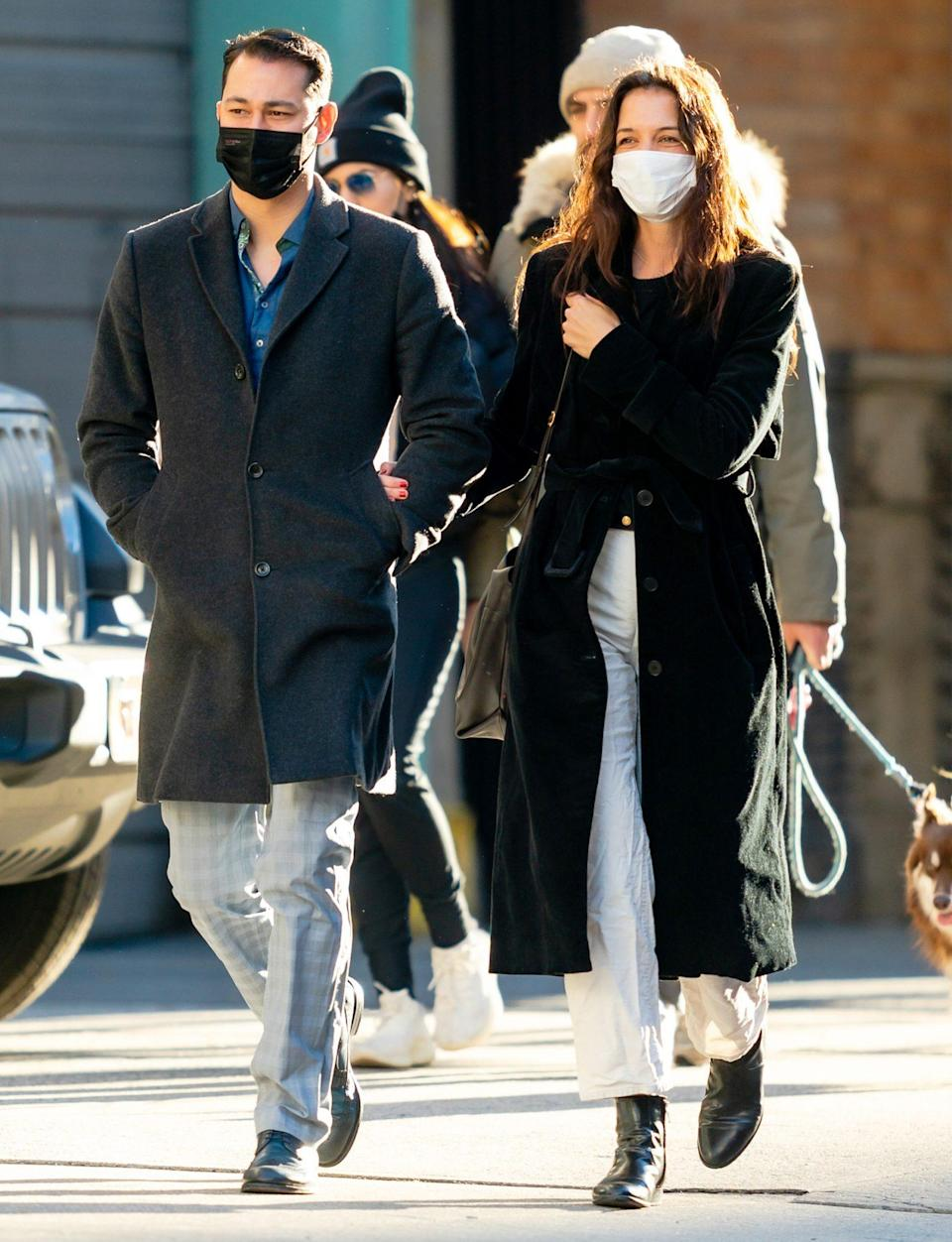<p>Katie Holmes and boyfriend Emilio Vitolo Jr. share laughs and enjoy their walk together through N.Y.C on Sunday.</p>