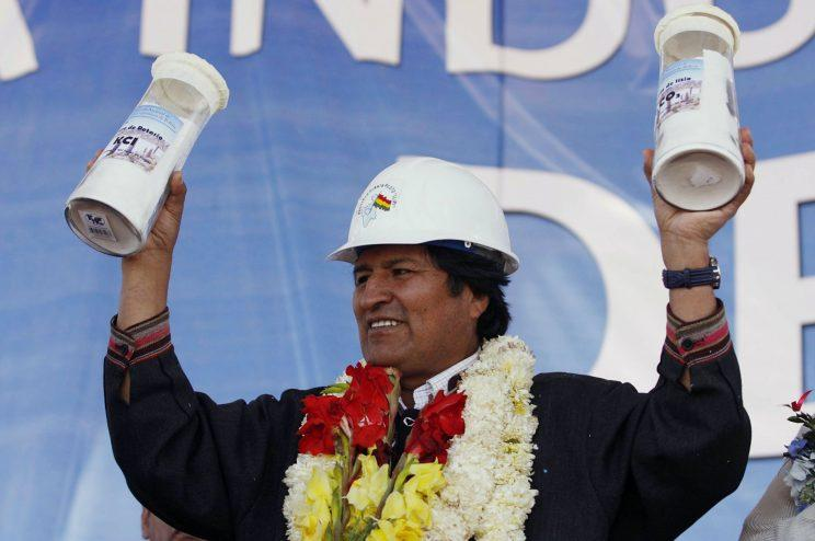 Bolivia's President Evo Morales holds containers with lithium carbonate and potassium produced at the Rio Grande lithium pilot plant, during a visit to the facility in Salar de Uyuni, southern Bolivia Thursday October 29, 2009. Salar de Uyuni is the world's largest salt flat at 10,582 km? (4,085 square miles) and holds around half the world's reserves of lithium. (Photo: Juan Karita/AP)