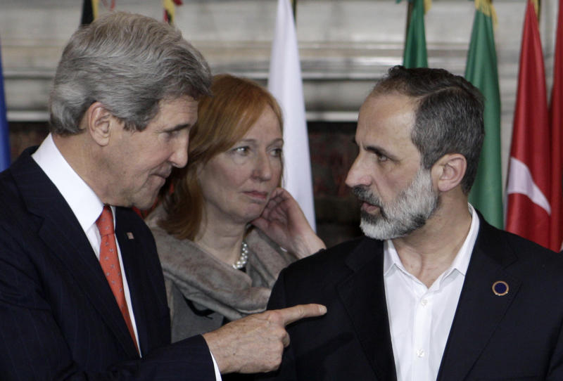U.S. Secretary of State John Kerry, left, talks to Syrian opposition coalition leader Mouaz al-Khatib, during an international conference on Syria at Villa Madama, Rome, Thursday, Feb. 28, 2013. The United States is looking for more tangible ways to support Syria's rebels and bolster a fledgling political movement that is struggling to deliver basic services after nearly two years of civil war, Kerry said Wednesday. (AP Photo/Riccardo De Luca)