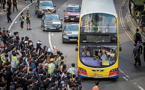 Demonstrators walk out onto Harcourt Road during a protest in the Admiralty district of Hong Kong, China, on Sunday, July 21, 2019. - Credit: Bloomberg