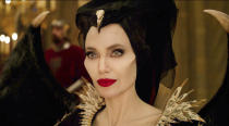"""This image released by Disney shows Angelina Jolie as Maleficent in a scene from """"Maleficent: Mistress of Evil."""" The film comes to Disney Plus Friday. (Disney via AP)"""