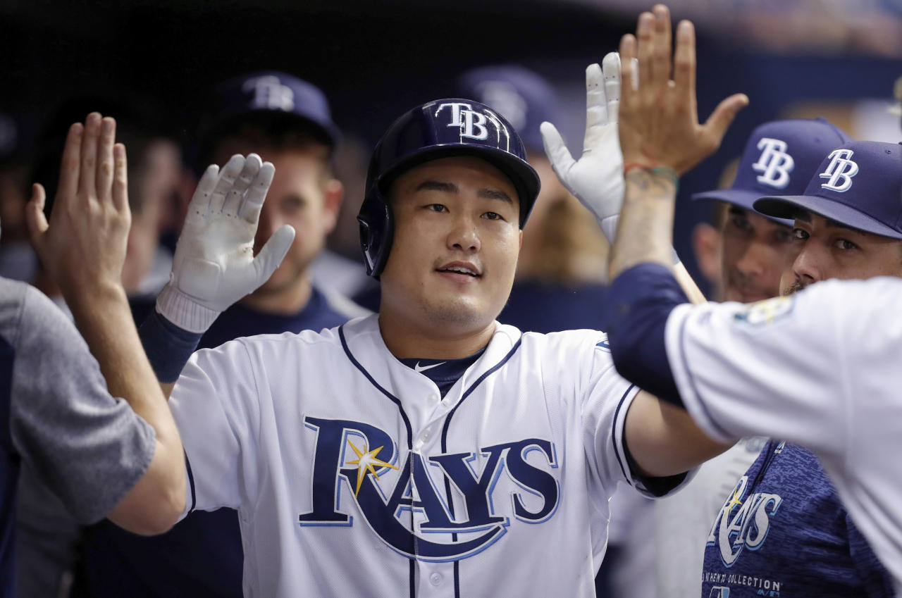 Tampa Bay Rays' Ji-Man Choi is congratulated on his home run during the ninth inning of a baseball game against the Miami Marlins, Saturday, July 21, 2018, in St. Petersburg, Fla. The Marlins won 3-2. (AP Photo/Mike Carlson)